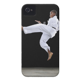 A Boy (15 Years Old) doing a front kick iPhone 4 Covers