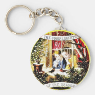 a boy and girl looking at the birds through window keychain