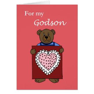 A boy bear holding a valentine card