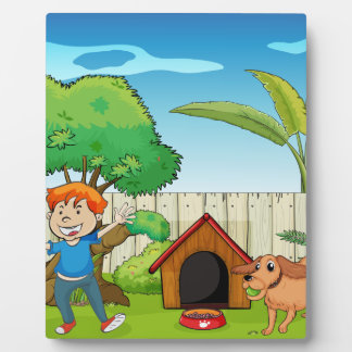 A boy dancing along with the dog plaques