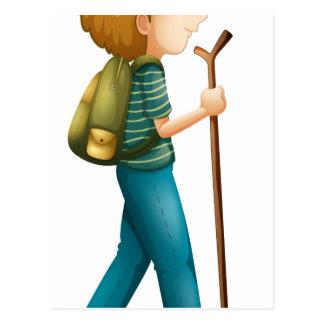 A boy hiking with a wood postcard