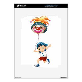 A boy holding a clown balloon decal for iPad 2