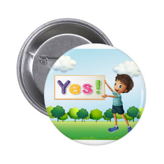 A boy holding a signboard 2 inch round button