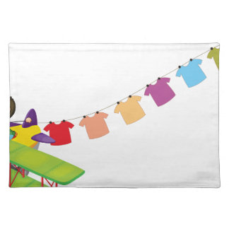 A boy in a plane with hanging clothes cloth place mat