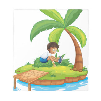 A boy jumping at the island note pads