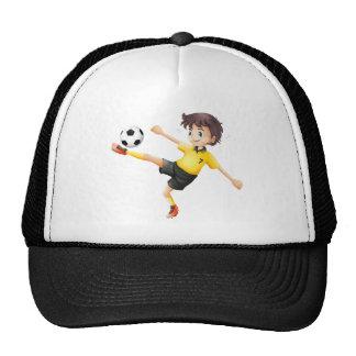 A boy kicking the soccer ball trucker hat