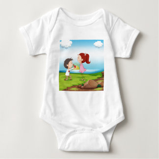 A boy making a marriage proposal at the riverbank baby bodysuit