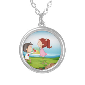 A boy making a marriage proposal at the riverbank silver plated necklace