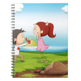 A boy making a marriage proposal at the riverbank spiral notebook