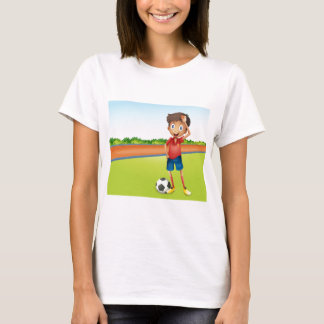 A boy playing football T-Shirt