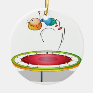A boy playing trampoline Double-Sided ceramic round christmas ornament