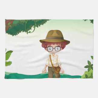 A boy standing on a timber beam towels