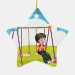 A boy swinging alone ceramic ornament