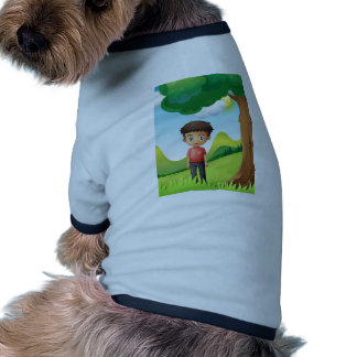 A boy under the shade of a big tree doggie t-shirt