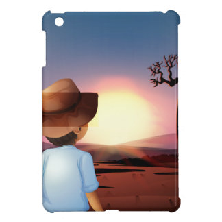A boy with a hat watching the sunset in the desert cover for the iPad mini