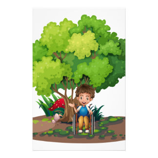 A boy with a wheelchair near the tree stationery