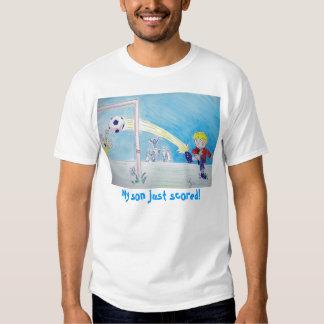 A boy's first goal playing football t shirt