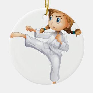 A brave girl doing karate ceramic ornament