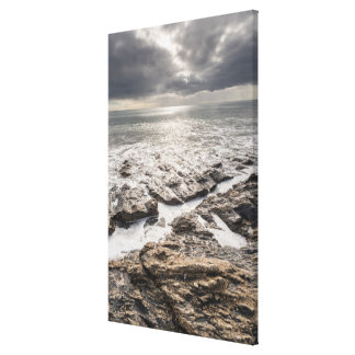 A Bright But Cloudy Day At Porthcurnick Beach Canvas Print