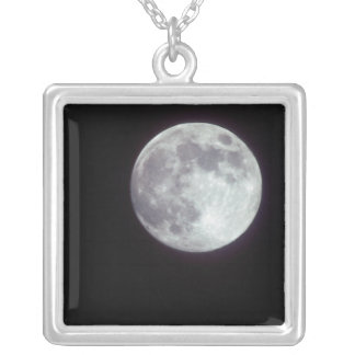 A bright full moon in a black night sky. silver plated necklace