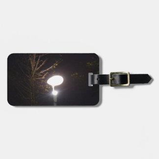 A bright lamp defeating the darkness of night tag for bags