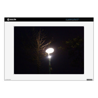 A bright lamp defeating the darkness of night laptop decal