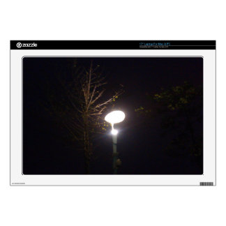 """A bright lamp defeating the darkness of night skin for 17"""" laptop"""