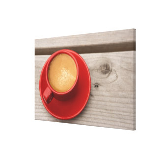 A bright red cup of espresso coffee on a picnic canvas print