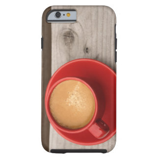A bright red cup of espresso coffee on a picnic tough iPhone 6 case