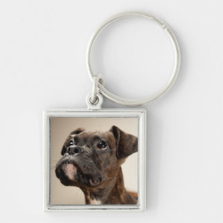 A Brindle Boxer puppy looking up curiously. Silver-Colored Square Keychain