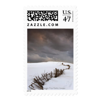 A Broken Fence Along A Snow Covered Field Postage