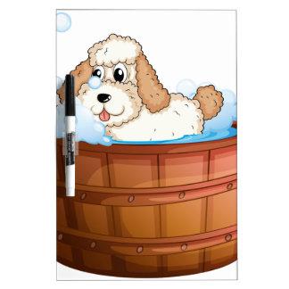 A brown bathtub with a dog taking a bath Dry-Erase boards