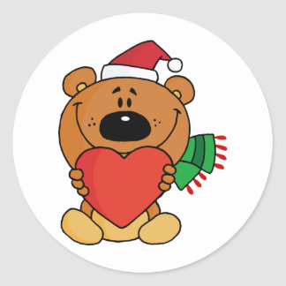 A brown bear holding a red heart classic round sticker