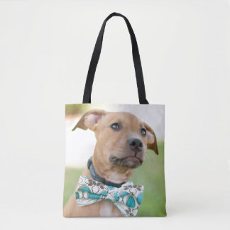 A Brown Puppy Wears A Colorful Bow Tie Tote Bag