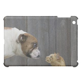 A Bulldog and a cat are face-to-face in a stand iPad Mini Cases
