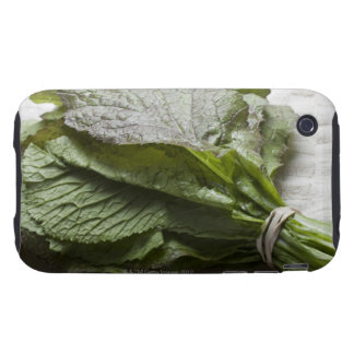 A bunch of fresh mustard greens, from a farmer's tough iPhone 3 covers