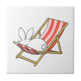 A bunny and a deckchair ceramic tile
