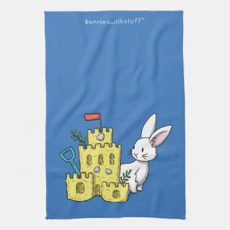 A bunny and a sandcastle kitchen towel