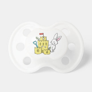 A bunny and a sandcastle pacifier