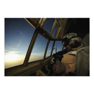 A C-130 Hercules pilot scans the horizon Photo Print