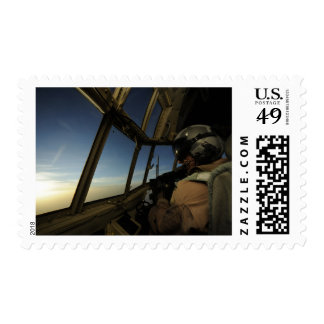 A C-130 Hercules pilot scans the horizon Postage