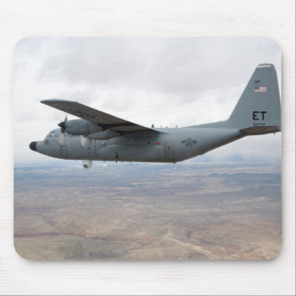 A C-130 Hercules soars through the sky Mouse Pad