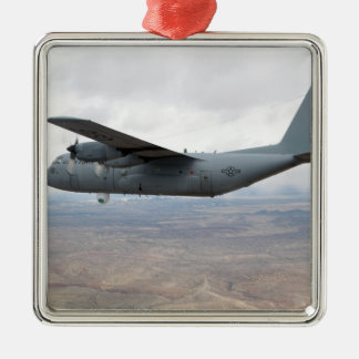 A C-130 Hercules soars through the sky Christmas Tree Ornaments