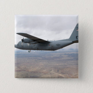 A C-130 Hercules soars through the sky Pinback Button