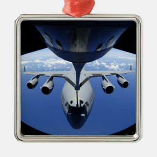 A C-17 Globemaster III receives fuel Christmas Ornaments