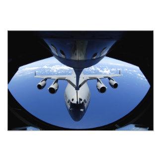 A C-17 Globemaster III receives fuel Photo Print