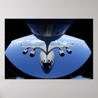 A C-17 Globemaster III receives fuel Poster