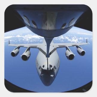 A C-17 Globemaster III receives fuel Square Sticker