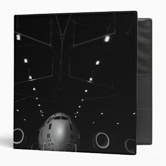 A C-17 Globemaster III sits in a hangar 3 Ring Binder