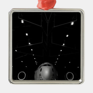A C-17 Globemaster III sits in a hangar Metal Ornament